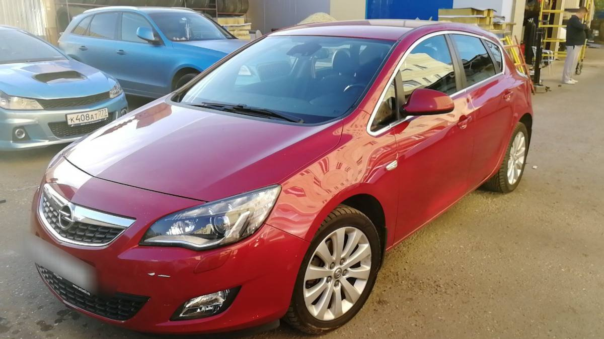 Opel Astra J 1.6 AT (180 л.с.) [2011]